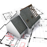 House on blueprints Stock Photo