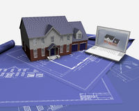 House on blueprints. 3D render of a house on blueprints with laptop Royalty Free Stock Photography