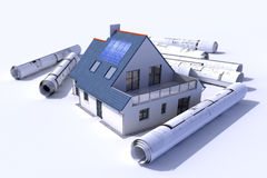 House and blueprints Royalty Free Stock Photos