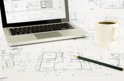 House blueprints and floor plan with laptop Stock Photography