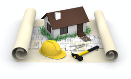 House, blueprints and yellow hard  hat Royalty Free Stock Photography