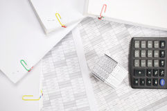 House with blur calculator and stack paperwork on finance account. House with blur calculator and stack paperwork place on finance account as background Royalty Free Stock Photos