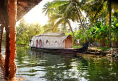 House boat. In backwaters at palms background in alappuzha, Kerala, India Stock Image