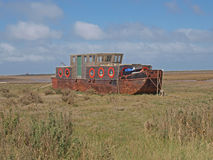 House boat. Old sand dredger being converted into a house boat on the salt marshes at Blakeney Royalty Free Stock Photo