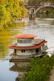 House boat along the Tiber river. Cross the river Tiber in Rome you can find, sometimes, houses boats moored on the river stock photography