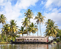 House boat in backwaters. At palms background In alappuzha, Kerala, India Royalty Free Stock Photo