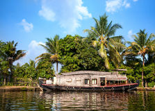 House boat in backwaters. At palms background In alappuzha, Kerala, India Stock Photo