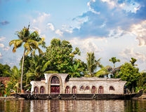 House boat in backwaters. At palms background in alappuzha, Kerala, India Royalty Free Stock Photography