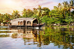 House boat in backwaters. Near palms at sunrise sky in Alappuzha, Kerala, India Royalty Free Stock Images
