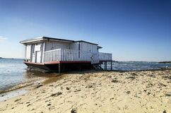 House Boat on the Beach. Old house boat on the beach at Studland in Dorset Stock Image