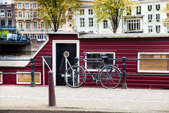 House boat with bicycle in Amsterdam Royalty Free Stock Photos