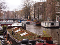 House boat on a canal in the Amsterdam Stock Photos