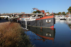 House boat on Canal du Rhone. House boat on the Canal du Rhone a Sete in Aigues-Mortes, France stock image