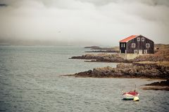 House and Boat in East Iceland Stock Image