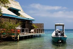 Caribbean House with Boat Stock Photography