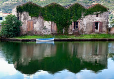 House and boat on the river. The Temo river in Bosa in Sardinia Royalty Free Stock Images
