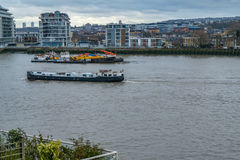 House boat traveling along the Thames at Greenwich. Stock Photo