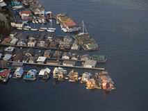 House Boats Along a Ship Canal. A group of house boats at sunset - aerial view Royalty Free Stock Photo