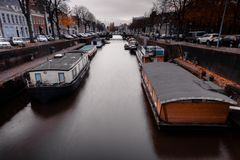 House boats on a canal in the Netherlands stock photography