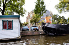 House boats and famous church in Amsterdam Royalty Free Stock Images