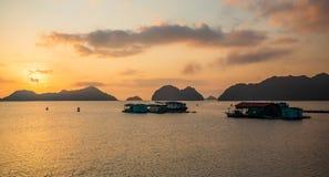 Sunset over Cat Ba island, Vietnam. House boats in Ha Long Bay near Cat Ba island, Vietnam. Houseboat, fishermen stock image