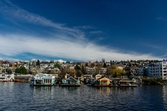 House Boats on Lake Union Seattle, Washington. Beautiful dark blue sky with a band of clouds Stock Photo