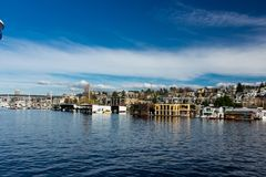 House Boats on Lake Union Seattle, Washington. Beautiful dark blue sky with a band of clouds Stock Photos