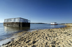 House Boats in Poole Harbour. House boat on the beach at Studland in Poole Harbour in Dorset Royalty Free Stock Images