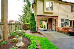 House with brick archway. View of antique fountain Stock Photography