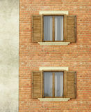 House with brick wall  and windows Stock Image