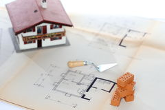 House and bricks and tools Stock Photography