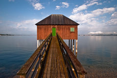 House with bridge at the lake. Beach house with bridge at the lake Royalty Free Stock Photos