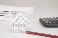 House and brown pencil have blur black calculator white background Stock Images