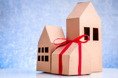 House in brown recycled paper on white floor Royalty Free Stock Photos