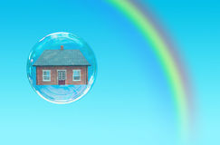 House bubble. House floating inside a bubble with a rainbow Stock Photography
