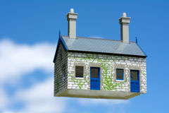 House bubble. Toy house hover in the air aginst blue sky . Concept photo of Real estate market bubble , booming, money,price, rent, grid, home, house, housing Royalty Free Stock Image