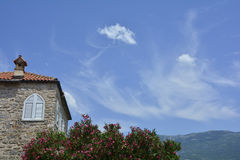 House in Budva. An historic house and blue summer sky in Budva old town, Montenegro Royalty Free Stock Images