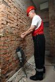 House-builder in uniforme con una legare-riga Immagini Stock Libere da Diritti