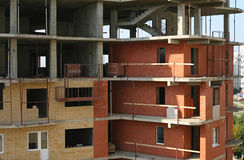 House building. Building of the brick many storeyed house Royalty Free Stock Photo