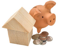 House of building blocks, coins and moneybox Royalty Free Stock Photo