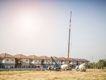House building at construction site with crane truck Royalty Free Stock Images