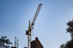 Construction work with a crane against the blue sky stock images