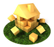 House Building in Garden. A house build of blocks and cubes, falling apart Royalty Free Stock Photo