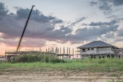 House building at construction site with crane truck Royalty Free Stock Photography