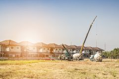 House building at construction site with crane truck Stock Photos