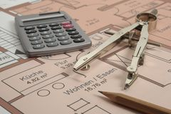 House building plan. With compasses and hand calculator Stock Photo