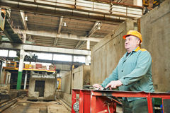 House-building plant. Industrial worker at house-building plant factory workshop Stock Photo