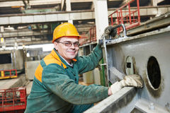 House-building plant labor. Industrial worker at house-building plant factory workshop Stock Photography