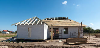 House building stage. Panoramic image of a house building stage, roof making Stock Photo