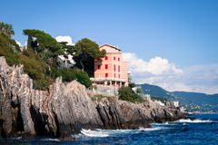 House built on a cliff in Genoa Stock Photos